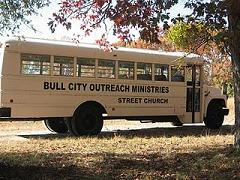 side view of Bull City Outreach Ministries Street Church bus with church name on side